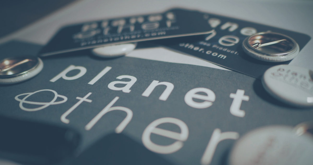 PlanetOther business cards and pins